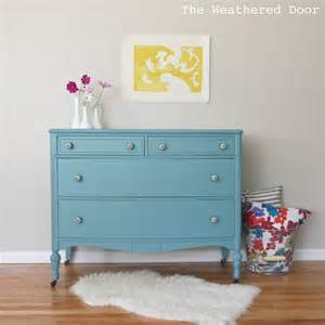 a bayside dresser with black and white knobs the