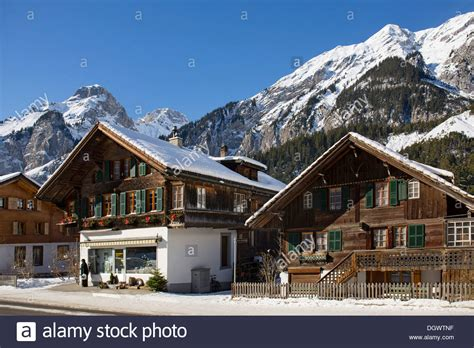 buying house in switzerland winter landscape and old wooden houses in kandersteg