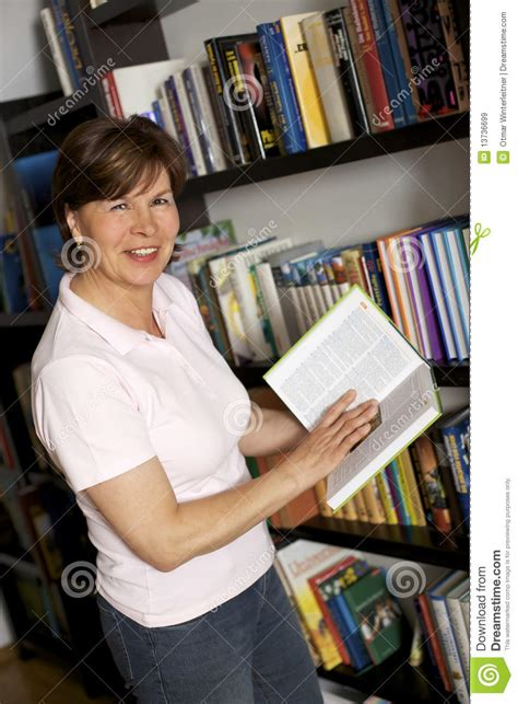senior pictures with books smiling senior carrying books royalty free stock