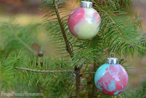 how to make paint swirled ornaments how to make your own swirled paint ornaments frugal family home