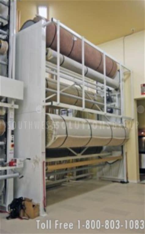 Carpet Carousel Of 3 by Revolving Carpet Carousel Seattle Storing Rolls Of