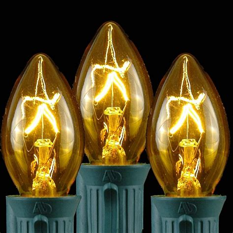 gold string lights yellow transparent c7 outdoor string light set on green wire novelty lights inc