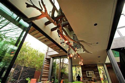 turned wood indoor outdoor chandelier marmol radziner house modern warm family friendly