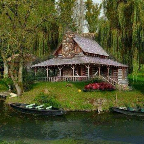 log home with wrap around porch like the offset steps and log cabin with wrap around porch on the lake love this