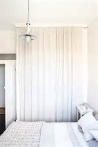 Out the closet doors and use a curtain rod to hang two white curtains
