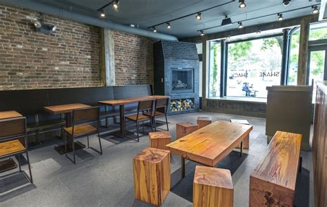 nycs newest shake shack features reclaimed furniture