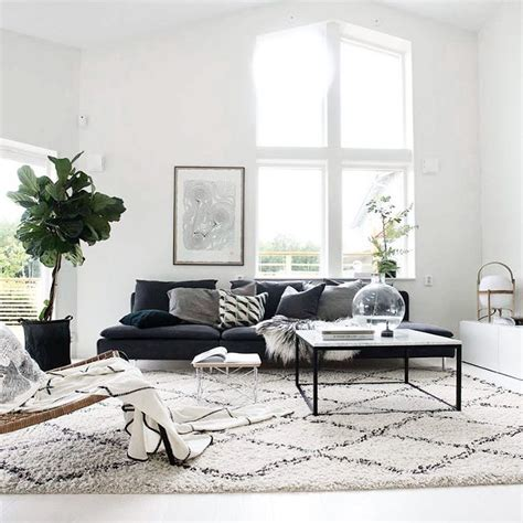 rugs for grey sofa scandinavian style living room with clean white walls