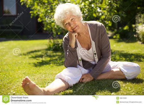 Backyard For Seniors Senior Sitting Relaxed In Backyard Stock Image