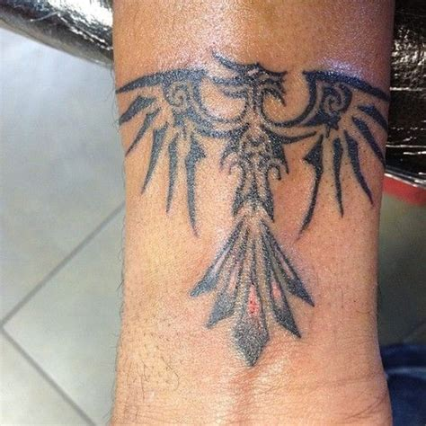 phoenix tattoo on wrist small wrist tribal phoenix tattoo