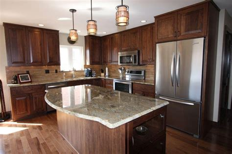 walnut kitchen cabinets granite countertops earth tone kitchen remodeled with walnut cabinetry