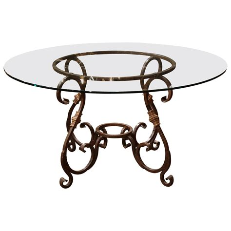 wrought iron french table base with round glass top for