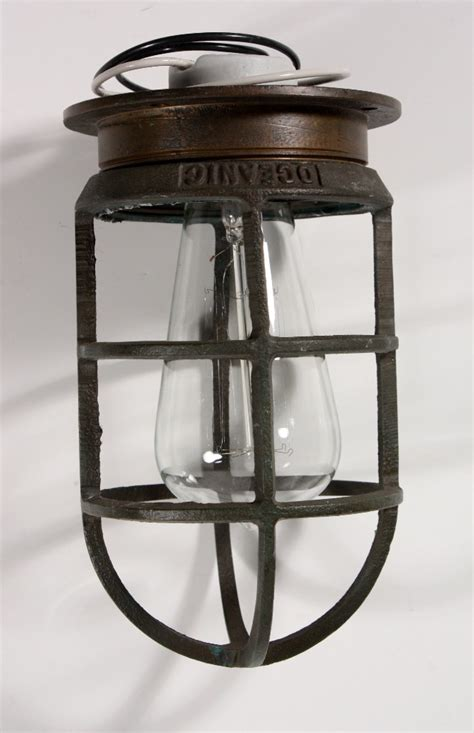 antique industrial cast bronze cage light fixture for wall