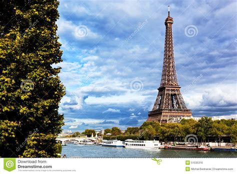 boat from eiffel tower to louvre eiffel tower and seine river paris france stock photo