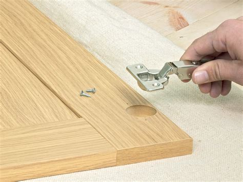 installing new cabinet hinges how to install new kitchen cabinets how tos diy