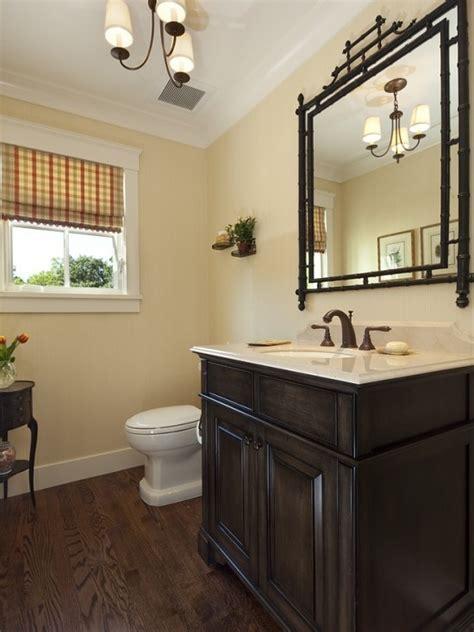 Pretty half bath; like the light fixture and dark wood
