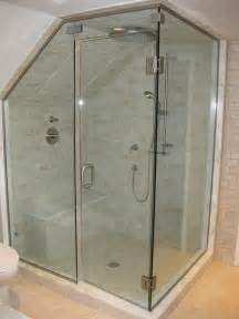 glass doors small bathroom: corner steam shower with slanted ceiling