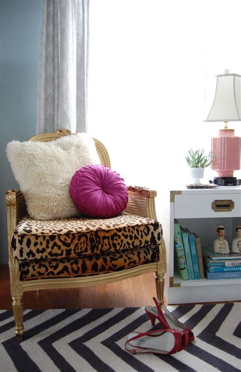 white fabric sofa combined with leopard table with black wooden legs gold bergere cane chair with jamil natural leopard print