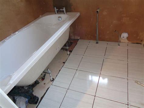 bathtub bong modern refitted bathroom with white grey tiles and chrome