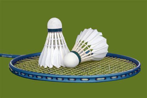 shuttlecock green pro by gs sport shuttlecocks and badminton racket free stock photo