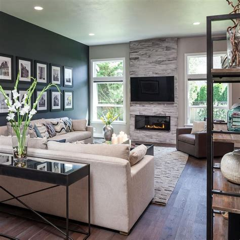 modern living the dark accent wall fireplace and custom wood floors add
