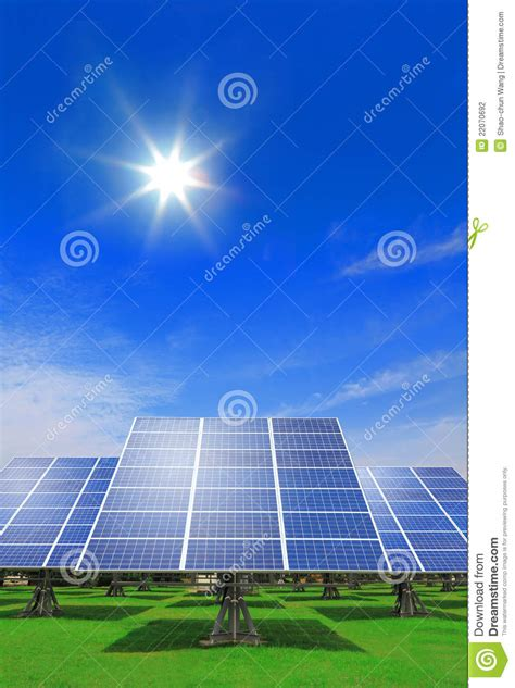 solar panel with green grass and blue sky stock