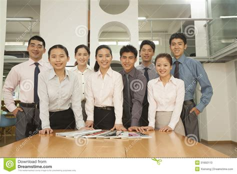 Office Team Office Team Standing Near The Desk Portrait Stock Photos