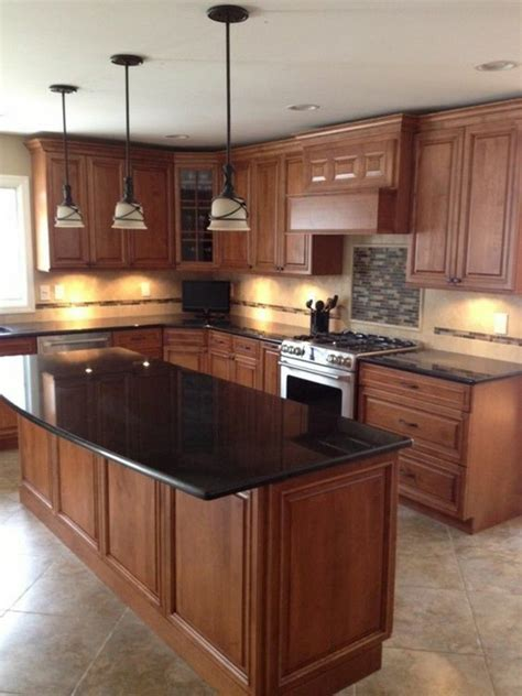 kitchen island with black granite top black granite countertops in a classic wooden kitchen with