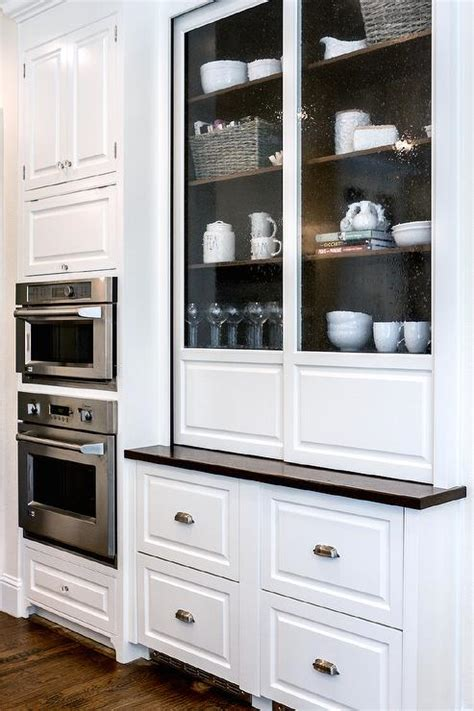 White Kitchen Cabinets With Glass Seeded Glass Kitchen Cabinets With Walnut Shelves Transitional Kitchen Benjamin