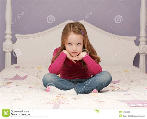 girl sitting on bed young girl sitting on bed royalty free stock images