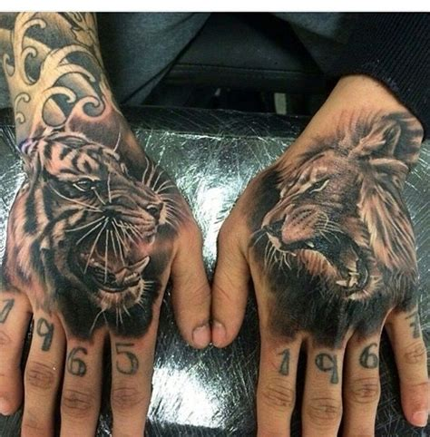 animal tattoo on hand tattoo tiger vs lion instagram pinteres