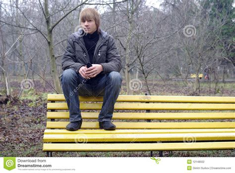 boys bench boy sitting on a bench stock photography image 12148502