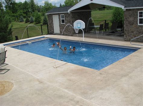 Brick Patio Contractors Rectangle Fiberglass Pool With Stamped Concrete And