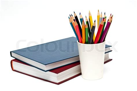 pictures of books and pencils a stack of color books and pencils on the white background