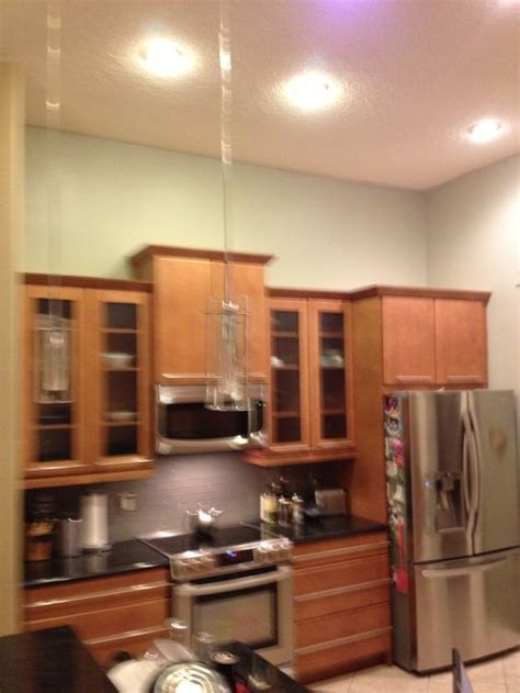 What To Put Above Kitchen Cabinets In A Tall Kitchen Putting Up Kitchen Cabinets
