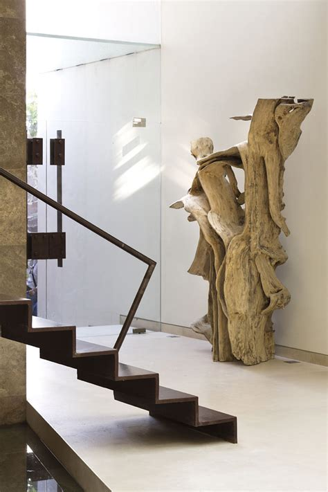 home sculptures glass doors wooden sculpture stairs modern family home