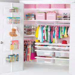 Hang shelves and racks within reach to organize toys clothes books