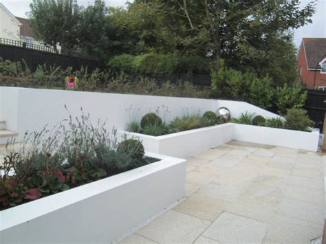 a contemporary family garden on a steep slope in reading