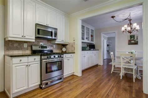 off white kitchen cabinets with stainless steel appliances thursday three hundred can you imagine a cuter tudor