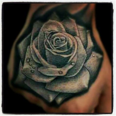 rose tattoo on hand with name blue rose hand tattoo by lalo pena lalo pena s amazing