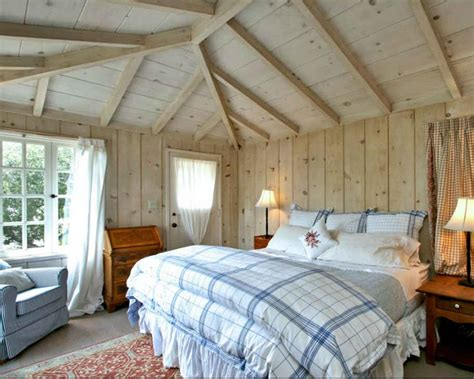 cottage bedroom with paneled walls and ceilings hooked