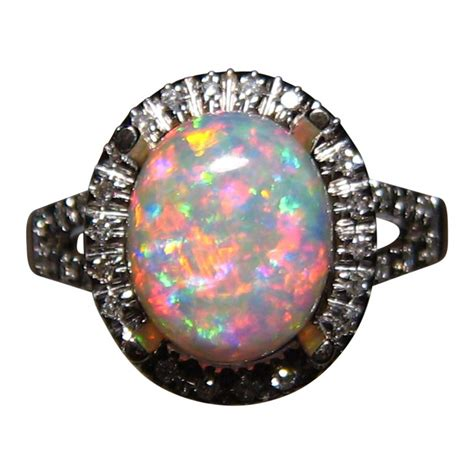 real blue opal red and blue opal ring with diamonds 14k gold flashopal