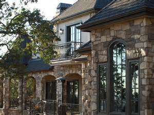French country home with stone rear exterior mediterranean exterior