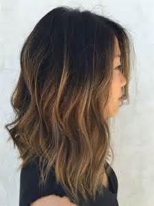 slightly longer in front hair cuts picture of textured bob with caramel ombre wavy hair