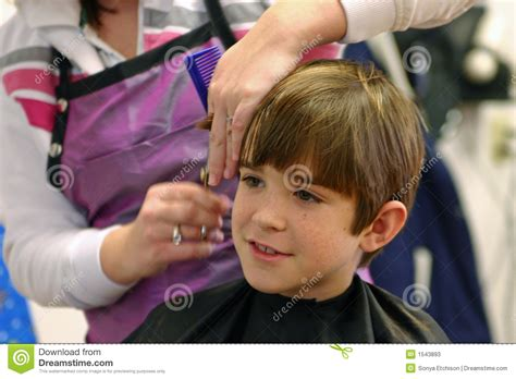 boys getting haircuts boy getting a haircut stock photos image 1543893