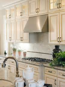 White Kitchen Cabinets by Antique White Kitchen With Wood Floors And An Island Sink
