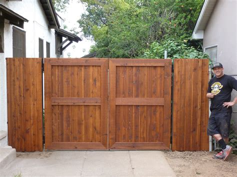 how to build a double swing gate wrought iron frame with wood overlay double swing gates