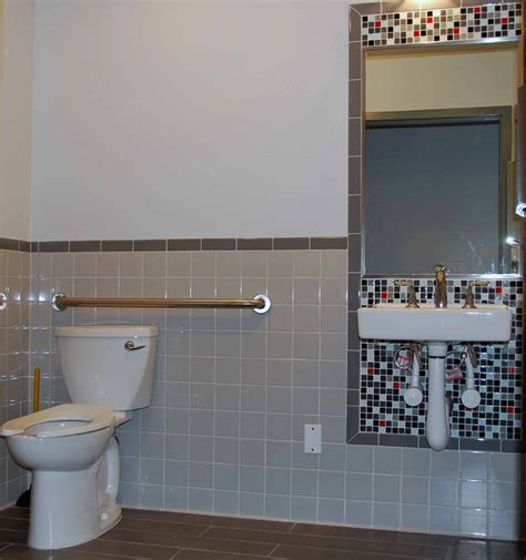 cheap cheerful tile design for an ada bathroom