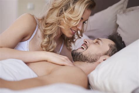 sex on the bed talking sweet couples in bed stock photo people stock