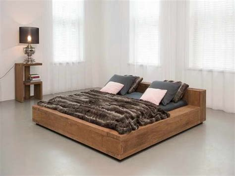 2 floor bed brown teak bed frame with black black blanket and grey