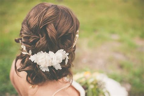 getting fullness on the hair crown romantic wedding updo with a bohemian floral crown